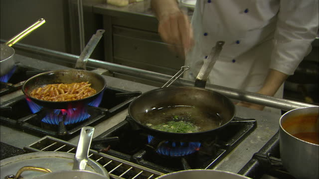 Italian chefs preparing food