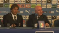 Italian national soccer team's new coach Antonio Conte and Italian Soccer Federation President Carlo Tavecchio speak during a press conference for...