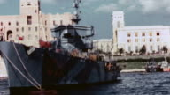DS Italian Navy cruiser anchored in harbor after the 1943 Armistice decorated with Regia Marina ensigns / Taranto Italy