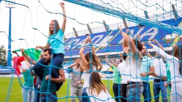 MS italian sport fans at dancing soccer stadium