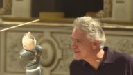 Italian tenor Andrea Bocelli's voice soars to the rafters of the Tuscan theatre but all eyes are on the orchestral conductor beside him a robot with...