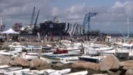 Italy's Costa Concordia cruise ship began emerging from its watery grave on Monday in an unprecedented salvage on a stunning island that could create...