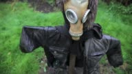 Items left after fighting between the proRussian separatists and the Ukrainian military are fashioned into a scarecrow in a heavily damaged village...