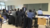 It's a far cry from the Jungle Since November 80 refugees from the Calais migrant camp have been taking preparatory classes at Lille university with...