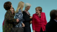Ivanka Trump speaking with the German chancelor at the end of the Womens20 Summit in Berlin 2017