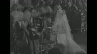 Jack Kelly escorts Grace down aisle of church / bridesmaids / Grace is led to chair / medium shot of Grace in veil / Rainier walks down aisle / Grace...