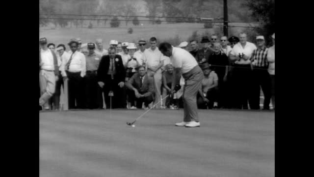 Jack Nicklaus Julius Boroz Arnold Palmer Bob Charles stand in a line at the NEC World Series of Golf Tournament / CU Nicklaus and Palmer / crowd...