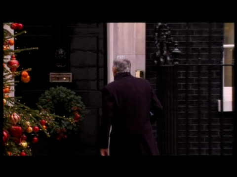 Jack Straw Justice Secretary arrives and knocks at Number 10 before entering