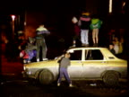Jack Straw plan for combatting youth crime ENGLAND Location Unknown Seq young boys jumping on car and wrecking it PULL OUT as on housing estate Int...