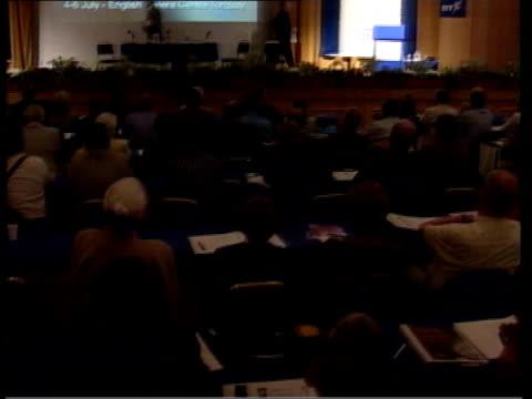 Jack Straw speeding row LIB HELD MILLBANK Jack Straw along onto podium for speech MS Jack Straw speaking at podium