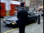 JO MILLBANK ENGLAND London Downing Street EXT GV Car carrying Jack Straw MP towards and pulls up MS Jack Straw out of car and greets police officer