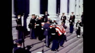 / Jackie Kennedy walking down steps escorted by Robert and Edward Kennedy / Mrs Kennedy precedes her husband's coffin as it leaves the Capitol...