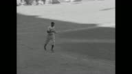 Jackie Robinson at bat receives a walk and jogs to first base / Robinson slides and steals second base / Robinson gets tagged out running to third...
