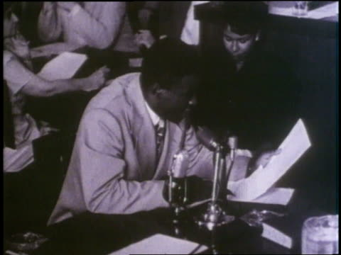 Jackie Robinson reads a statement against racism while testifying before Congress