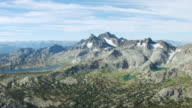 WS AERIAL POV Jagged Mountain Peaks range including Mount Ritter Banner Peak and Mount Davis with ThoUnited Statesnd Island Lake and small alpine lakes in Yosemite National Park / California, United States