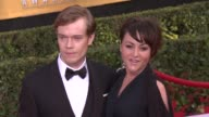 Jaime Winstone and Alfie Allen at 20th Annual Screen Actors Guild Awards Arrivals at The Shrine Auditorium on in Los Angeles California