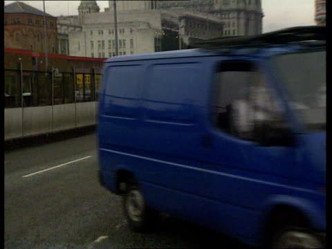Liverpool Police van towards and past LR followed by another PAN LR as into Liverpool Crown Court