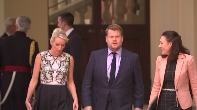 London Buckingham Palace Corden interview SOT I hope it doesn't change anything Corden and wife Julia Carey along