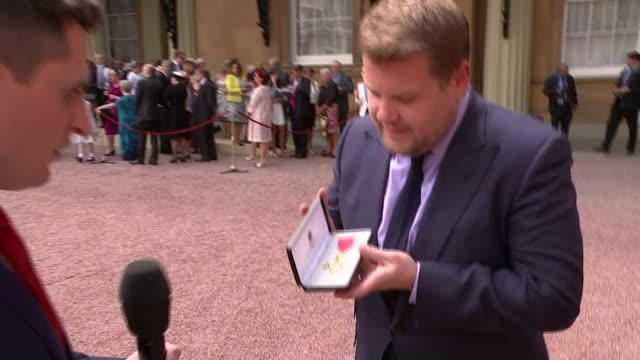 James Corden awarded OBE EXT Corden showing reporter his OBE James Corden interview SOT A little overwhelming