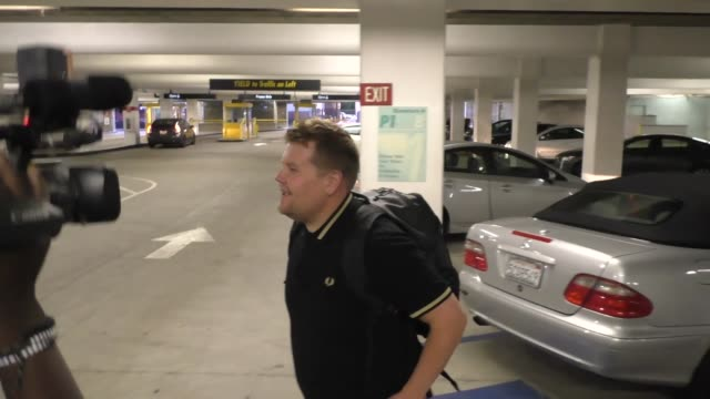 James Corden leaves ArcLight Theatre after throwing popcorn on Kevin Corrigan for having his phone on in theatre in Celebrity Sightings in Los Angeles