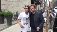 James Corden poses with a fan outside the Crosby Street Hotel NYC Celebrity Sightings in New York on June 26 2014 in New York City