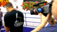 James DeGale training DeGale training in ring / coach talking to DeGale and other boxers / DeGale being prepared for sparring