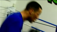 London INT James DeGale sparring in boxing ring during training session in gym punching padded gloves held by trainer