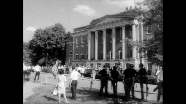/ James Hood and Vivian Malone register at University of Alabama ending segregation at the school / large crowd outside the University of Alabama...