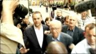 James Murdoch resigns as Chairman of BSkyB LIB London THROUGHOUT** James Murdoch and Rupert Murdoch along together through press scrum