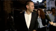 James Murdoch resigns as Chairman of BSkyB R10071107 / 1072011 Rebekah Brooks and James Murdoch towards from restaurant with others EXT / NIGHT Colin...