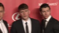 Jamie Cook Matt Helders Alex Turner at 2015 MusiCares Person Of The Year Gala Honoring Bob Dylan at Los Angeles Convention Center on February 06 2015...