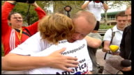 Jane Tomlinson completes transAmerica cycle ride New York Battery Park Back View Jane hugged by husband Mike Steven Tomlinson interview SOT there's...