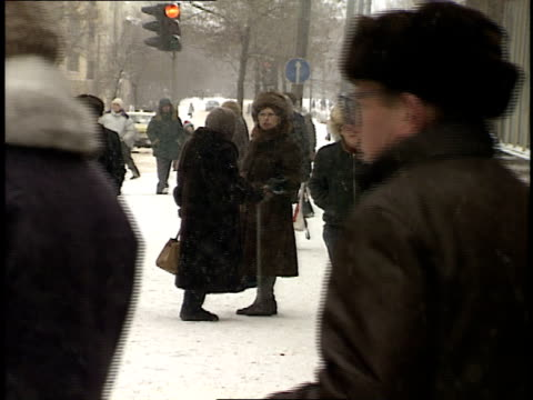 January 2 1992 WS Pedestrians walking down snowy street in Moscow Russia