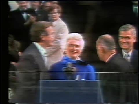 January 20 1981 George Bush shakes hand with Justice kisses Barbara waves at inauguration