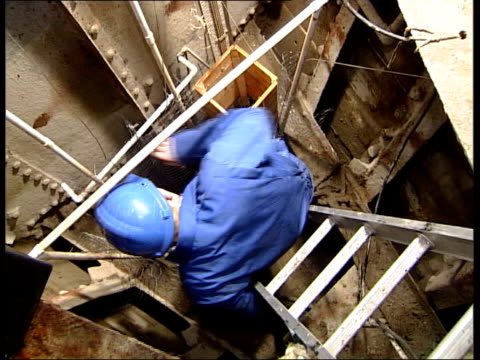 January 2004 Technician attaching chicken wire attached to wooden strut Technician away up steps EXT Man carrying wire structure along deck INT SHIP...