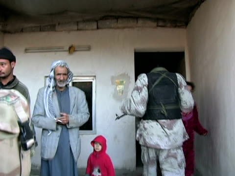 January 21 2005 MONTAGE US Army and Iraqi National Guard searching small village for weapons Baghdad Iraq AUDIO