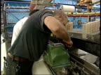 January 29 2004 TS Workers operating a loom at a textile mill / South Carolina United States