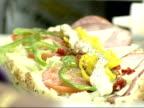 January 3 2003 CU Employee preparing a sandwich at Subway sandwich shop / United States