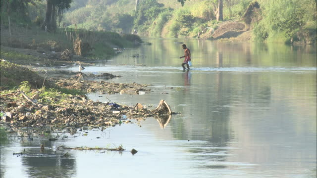January 5 2011 WS Local walking across the shallow waters of the Artibonite River / Haiti