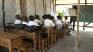 January 6 2011 MONTAGE Students learning lesson from teacher in classroom / Leogane Haiti