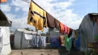 January 6 2011 LA Shacks of makeshift tent city beyond hanging laundry / Haiti