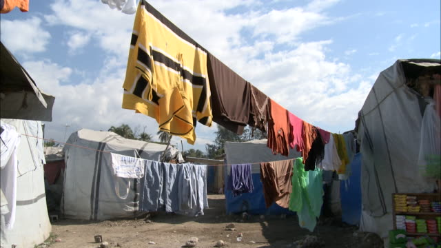 January 6 2011 LA Shacks of makeshift tent city beyond hanging laundry / Haiti