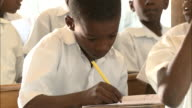 January 6 2011 MS Student taking notes and listening to lesson in classroom / Leogane Haiti