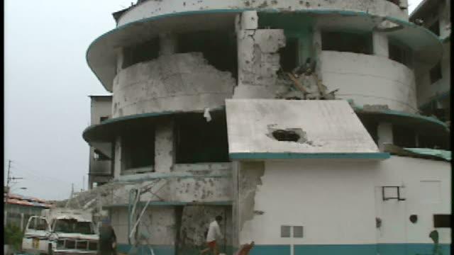 January 8 1990 PAN People milling around a damaged building / Panama City Panama