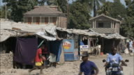 January 8 2011 WS Stalls and makeshift tents along a village street / Leogane Haiti