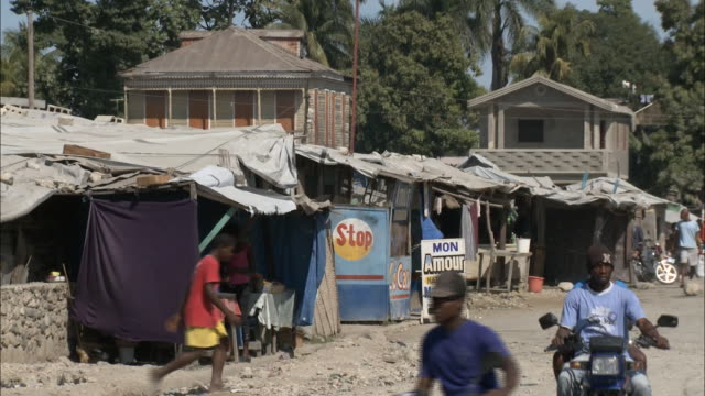 January 8 2011 WS Stalls and makeshift tents along a village street / Leogane Haiti