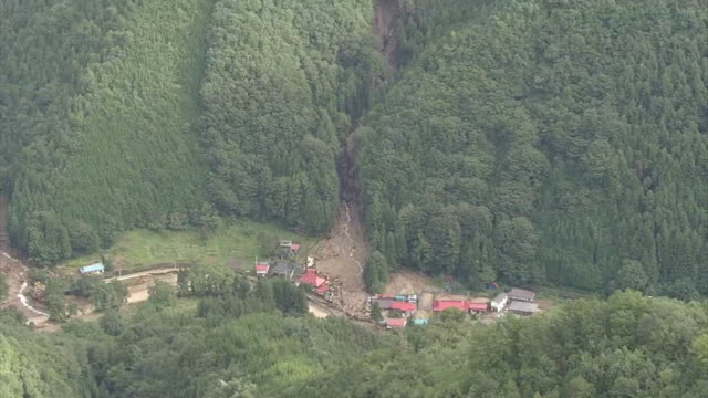 [Japan Out]High angle aerial view of a valley of a mountain Severe downpour caused multiple landslides on the mountain surface Tilt down affected...
