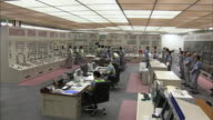 [Japan Out]Wide angle view Entire view of the Sendai nuclear power plant's central control room Workers checking the reactor's power generation and...