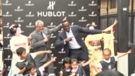 The world's fastest man Usain Bolt delighted local children and 'maiko' in Kyoto on Tuesday with his trademark 'lightning bolt' pose as he attended a...