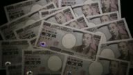 Japanese 10000 yen banknotes are arranged for a photograph in Tokyo Japan on Wednesday July 22 2015 Shots CU of money piles x 2 slow pan right over...